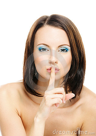 Woman puts forefinger to lips