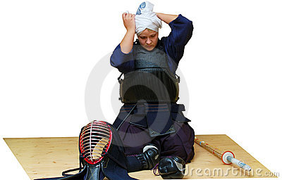 A woman puts on kendo uniform