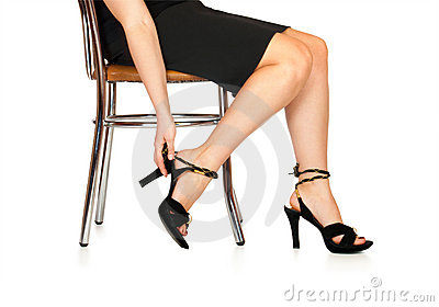 The woman puts shoes sitting a chair