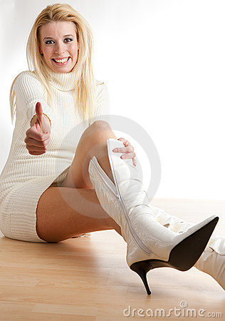 Woman putting on boots