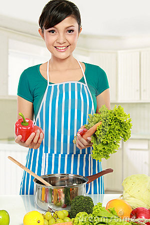 Woman putting a bunch of healthy ingredients