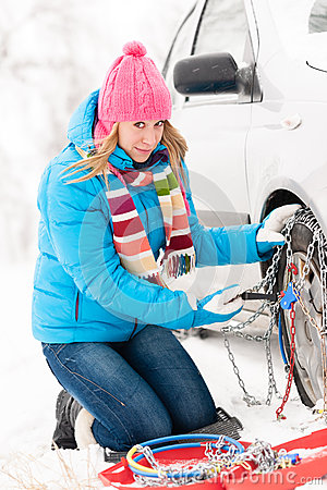 Free Woman Putting Chains On Car Winter Tires Royalty Free Stock Images - 27155599