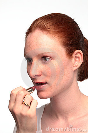 Woman Putting Lipstick