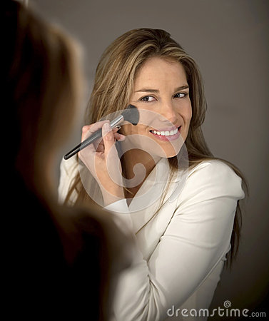 Woman putting make up
