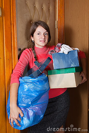 Woman putting out the garbage
