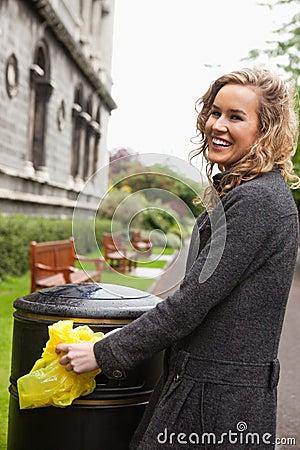 Free Woman Putting Plastic Waste In Garbage Bin Royalty Free Stock Photos - 18359968