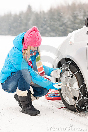 Free Woman Putting Winter Tire Chains Car Wheel Stock Photo - 27086810