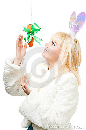Woman in rabbit costume stretch out for carrot
