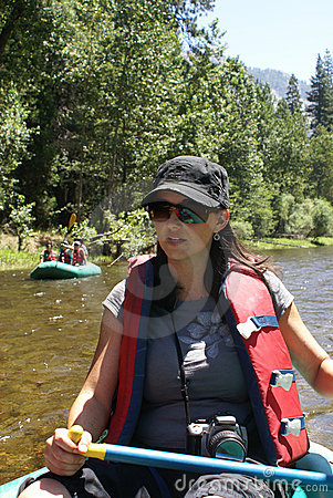 Woman Rafting On River