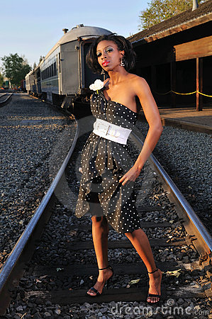 Woman by railroad tracks