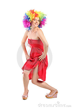 Woman in rainbow clown wig with freckles posing