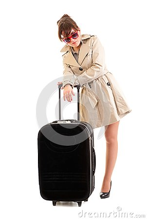 Woman in a raincoat with a suitcase