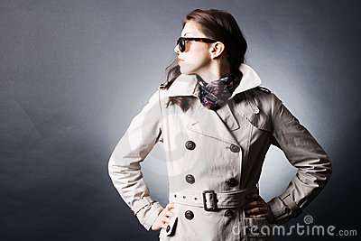 Woman in the raincoat and sunglasses