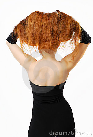 Woman with raised red hair and nude back