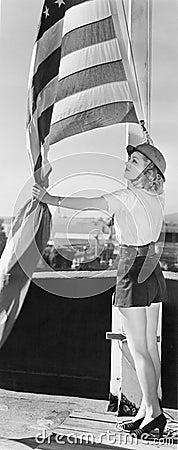 Free Woman Raising American Flag Royalty Free Stock Image - 52006806