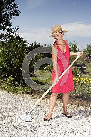 Woman raking the garden path
