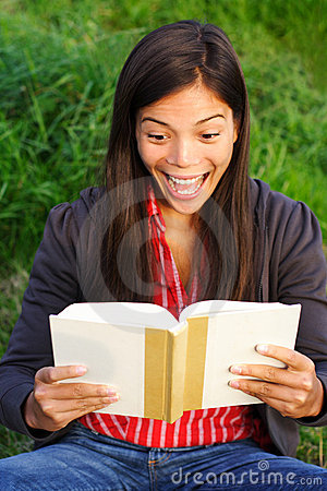 woman reading a book excited