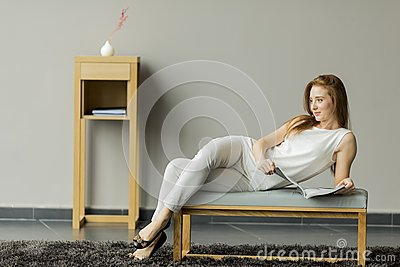 Woman reading a book in the room