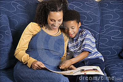 Woman Reading Book to Son