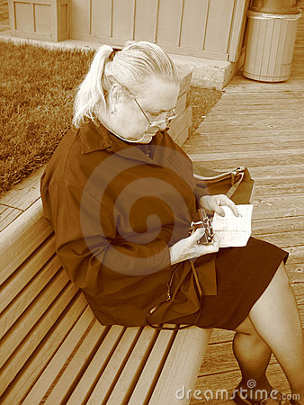 Woman reading camera book