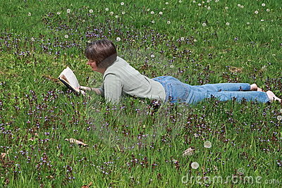 Woman reading in field