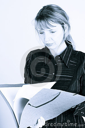 A woman reading through a folder (2)