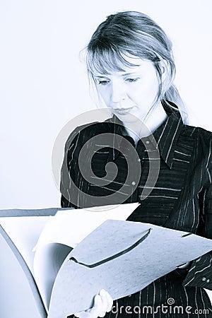 A woman reading through a folder (2)