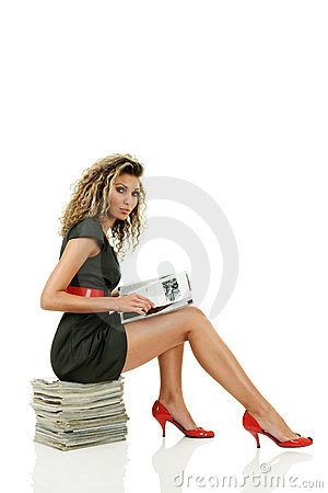 Free Woman Reading Glossy Magazines Stock Image - 18070191
