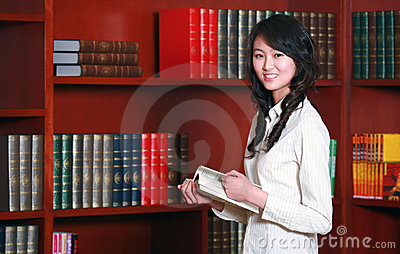 Woman reading in library