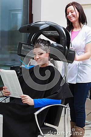 Woman reading magazine in hair salon stock photo image for Reading beauty salon
