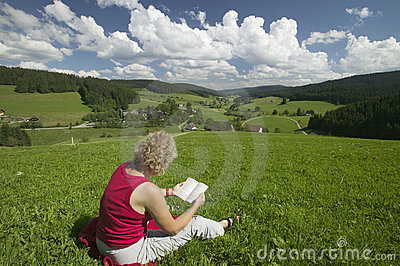 Woman reading on the meadow