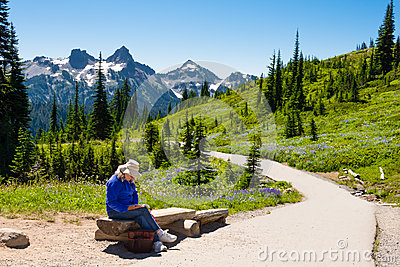 Woman Reading in Mountains