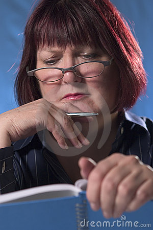Woman reading notebook 2