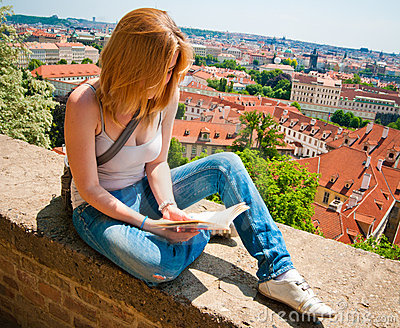 Woman reading in Prague