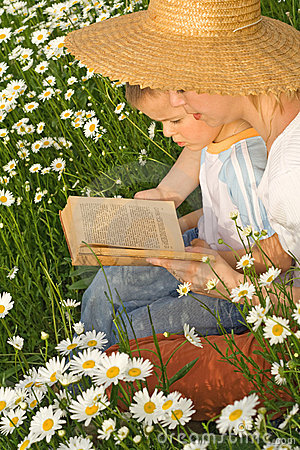 Woman reading a story to her little boy