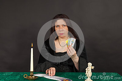 A woman is reading tarot cards