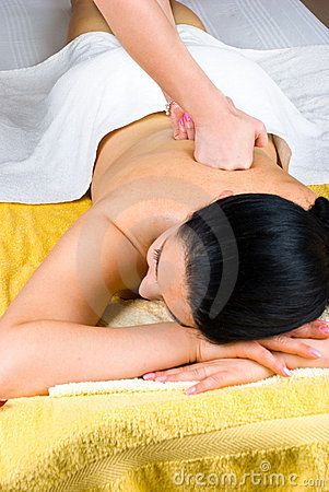 Woman receiving deep back massage at spa