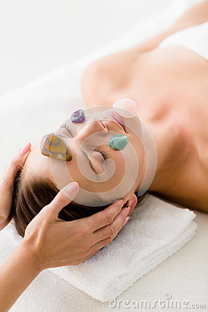 Free Woman Receiving Facial Stone Massage From Masseur Stock Photography - 77700302