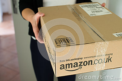 Woman receiving parcel Editorial Stock Image