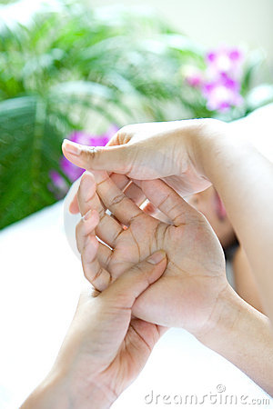 Woman receiving relaxing hand massage