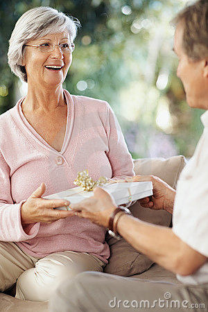 Woman recieving gift on their anniversary