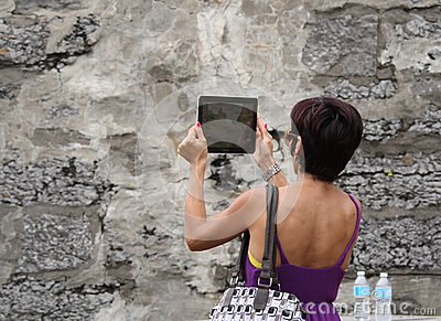 Woman Recording Festival with Tablet Editorial Image