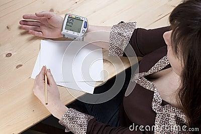 Woman recording pressure