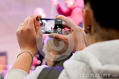 Woman is recording the show Editorial Image