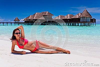 Woman in red bikini in beach destination