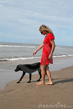 Woman in red and black dog