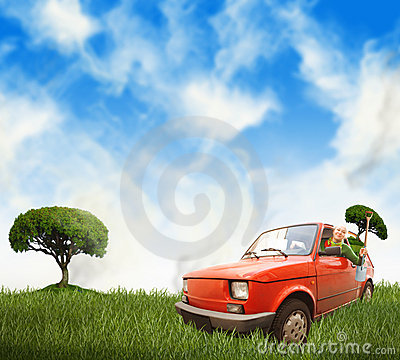 Woman in red car on a meadow
