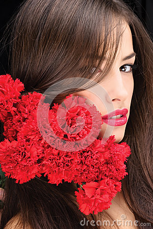 Woman and red carnations