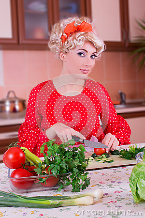 Woman in red cutting vegetables