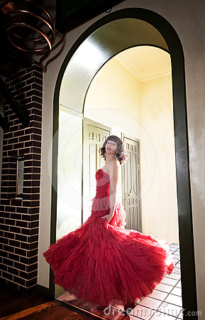 Woman in red at the door